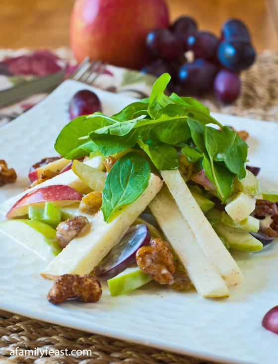 A delicious recipe for Waldorf Salad - apples, pears, walnuts, celery, raisins in a creamy mayonnaise-yogurt dressing with cinnamon, orange and lemon