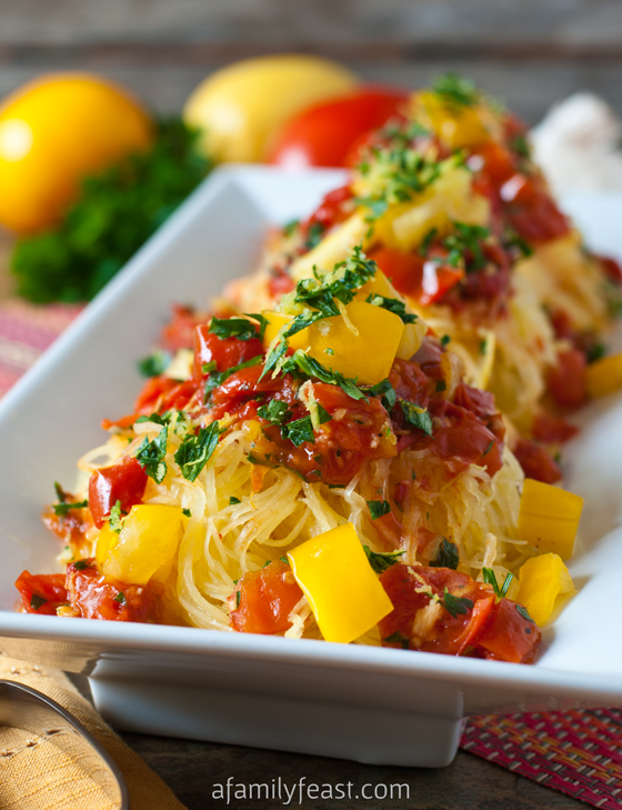 Spaghetti Squash Gremolata - Tender roasted spaghetti squash tossed with pan roasted tomatoes and a wonderful gremolata of lemon zest, garlic and parsley. This recipe is amazing!