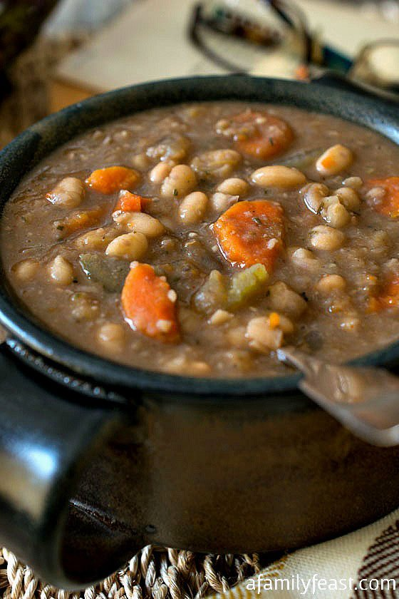 Slow Cooker Tuscan White Bean Soup - A simple, flavorful and hearty soup!